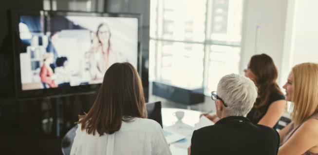 business people watching a webinar