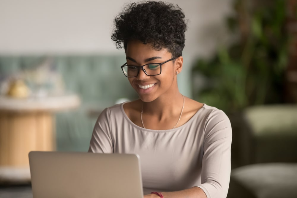 Woman on laptop participating in a webinar