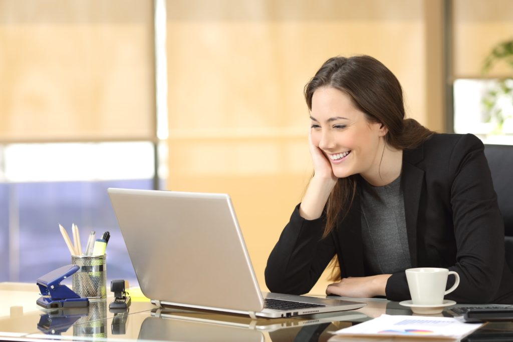 Woman video-conferencing at laptop