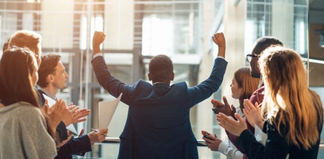Man celebrating a sales pitch