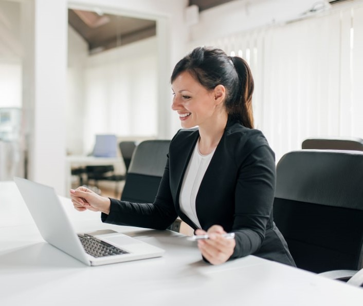 Business woman on laptop presenting online